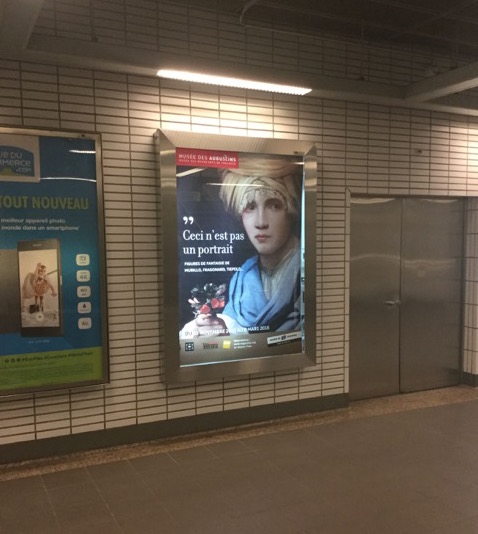 Exhibition poster of Sweerts's Boy with a Turban in the Toulouse metro. Photo: Melissa Percival.