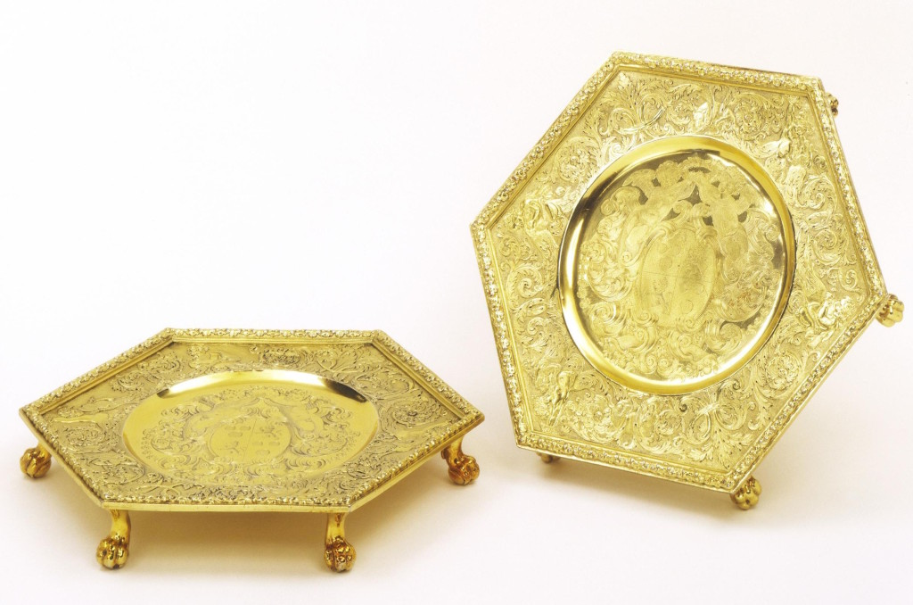 Benjamin Pyne, set of four waiters from Powderham Castle, 1698-1699, silver gilt dishes, cast and engraved. © Victoria and Albert Museum, London.